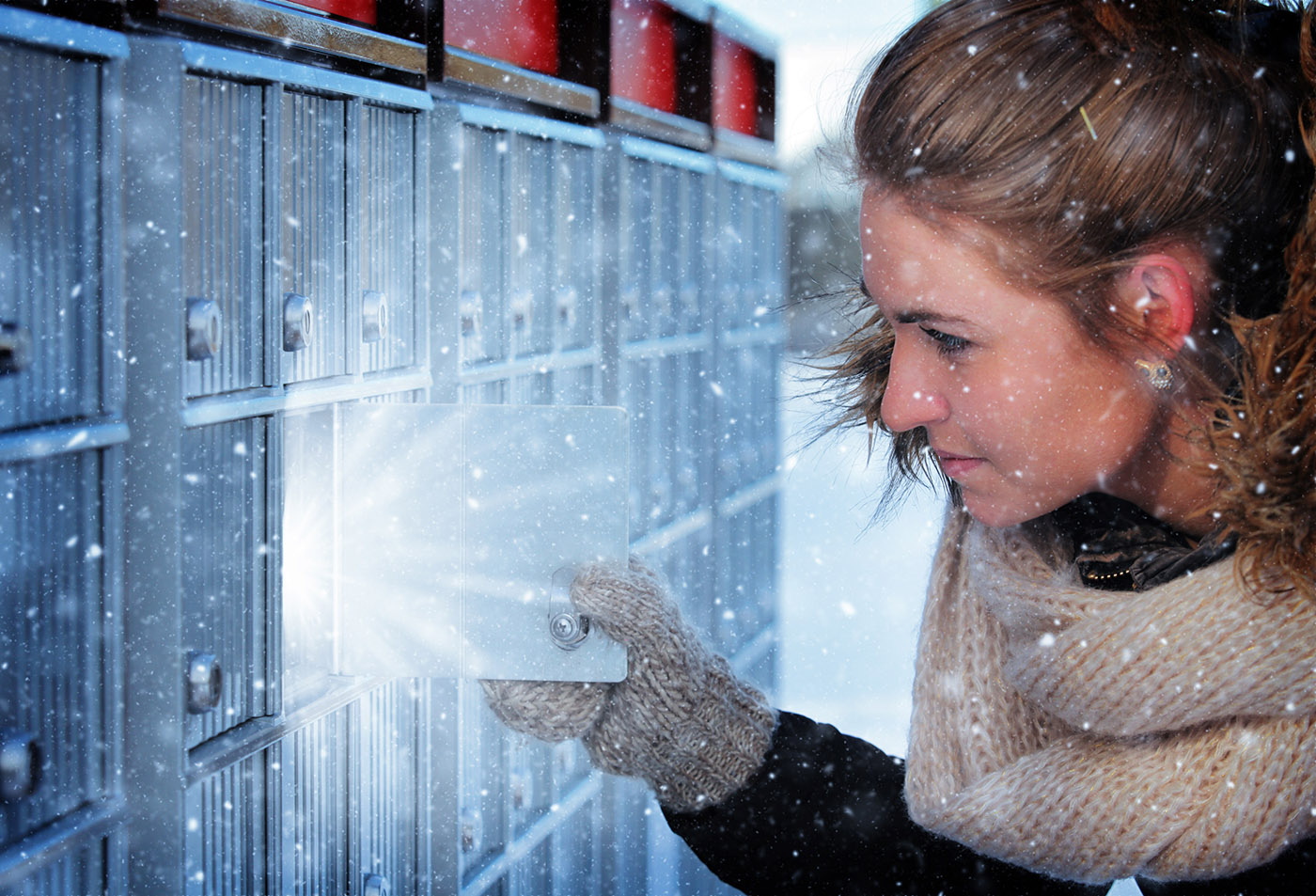 Pretty Woman Looking at Highlighted Mailbox in Winter - RF Stock Image